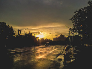 Sunset in city after rain