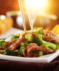 eating chinese beef and broccoli stir fry