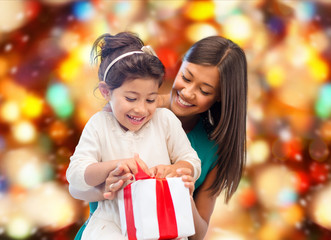 happy mother and little girl with gift box