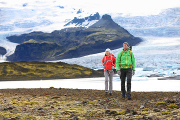 Adventure hiking travel couple trekking on Iceland