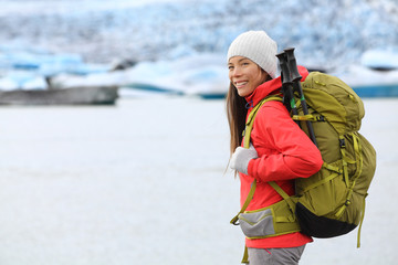 Hiking adventure trekking woman by glacier Iceland
