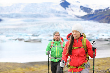 Adventure hiking people by glacier on Iceland