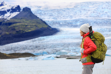 Adventure hiking woman by glacier on Iceland