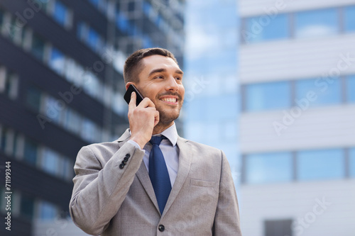 canvas print picture smiling businessman with smartphone outdoors