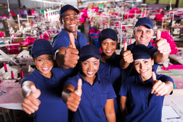 group of clothing factory co-workers thumbs up