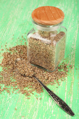 Bay seeds in a glass square bottle with wooden lid