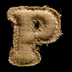 Linen or hemp vintage cloth letter P isolated on black
