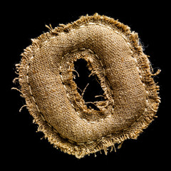 Linen or hemp vintage cloth letter O isolated on black