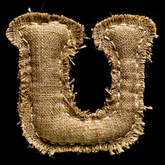 Linen or hemp vintage cloth letter U isolated on black