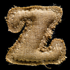 Linen or hemp vintage cloth letter Z isolated on black