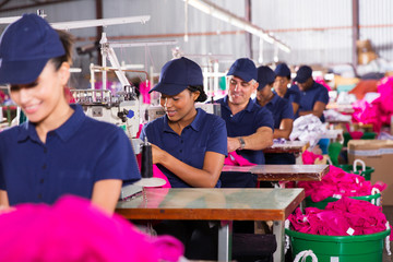 multiracial factory workers sewing