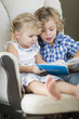 Young Brother and Sister Reading a Book Together
