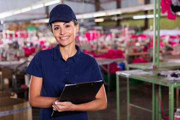 clothing factory supervisor standing in production area