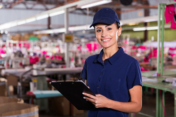 female clothing factory worker with clipboard