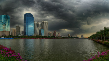 Rain and stormy clouds over cityscape, Bangkok, Thailand