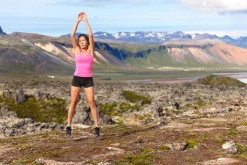 Fitness woman jumping exercising outdoors