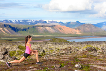 Fitness girl doing lunges exercise in nature