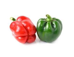 Green, red bell peppers on a white background