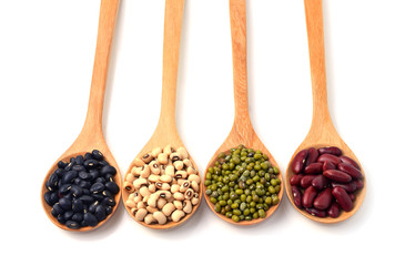 Green beans, black beans, red beans in wooden spoon, white backg