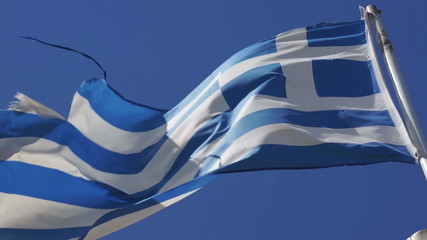 Greek flag waving in blue sky