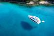 Leinwandbild Motiv Boat, clear water - caribbean paradise