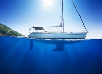 Sunlight seaview to sailboat in tropical sea with deep blue