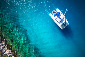 View to catamaran sailing in open sea at windy day. Drone view