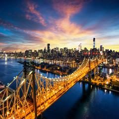 New York City - sunset over manhattan with Queensboro bridge