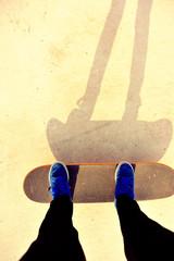 woman legs skateboarding at skatepark ramp