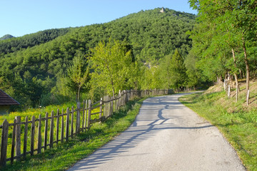 Rural Road With Wooden Fence In Serbia