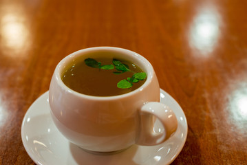glass cup with green tea and mint