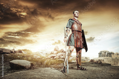 Ancient Greek warrior fighting in the combat - 71208171