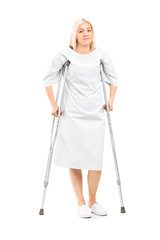 Female patient posing with crutches