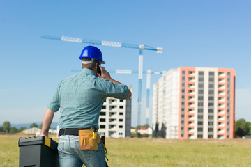 conversation on residential construction site
