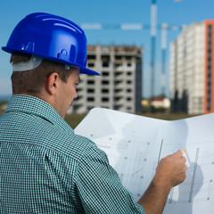 engineer reading construction plan
