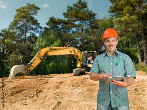 engineer with digital tablet on construction site - 71209557