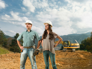 young engineers supervising construction