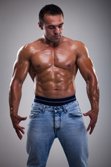 Portrait of a handsome muscular bodybuilder posing