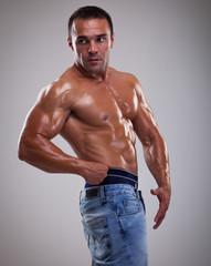 Portrait of a handsome muscular bodybuilder posing