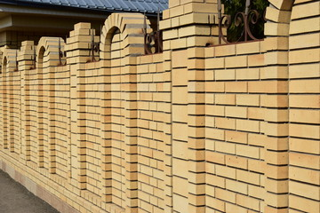 An attractive brick fence with posts