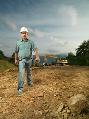 confident engineer on construction site