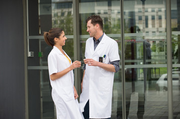 Doctors talking to each other and smiling