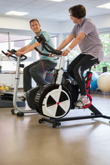 Man and woman in a spinning class at the gym