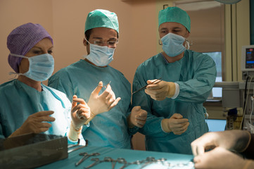 Surgeons operating a patient in an operating room
