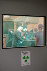 Medical team operating a patient in an operating room
