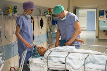 Doctor and nurse attending a patient in recovery room