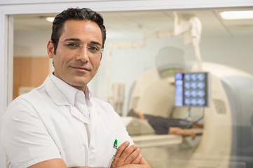 Portrait of a male doctor in medical MRI scan room
