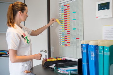Female nurse arranging schedule in hospital