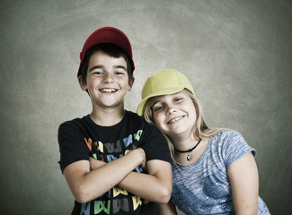 portrait of couple of children with caps current