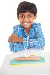 Cute elementary pupil smiling at camera